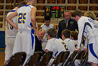 Gilford's Coach Chip Veazey and Coach Greg Madore during a time out in the third quarter of the first round tournament matchup with Stevens High School on Thursday evening.  (Karen Bobotas/for the Laconia Daily Sun)