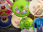 """07 APRIL 2013 - CHIANG MAI, CHIANG MAI, THAILAND:  Decorative paper umbrellas for sale on Chiang Mai's """"Walking Street"""" market. The Walking Street Market starts at Thapae Gate and runs along the length of Ratchadamnoen Road through the heart of the Old City and has become a Chiang Mai institution. Chiang Mai is the largest town in northern Thailand and is popular with tourists and backpackers.       PHOTO BY JACK KURTZ"""