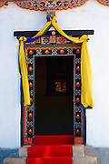 Traditional decorated doorway of the Institute of Traditional Medicine with a modern day fluorescent light above it, Paro, Bhutan.