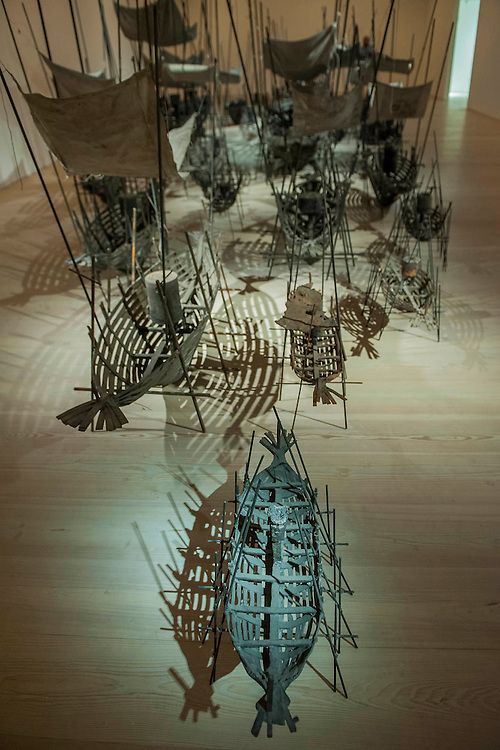 """Departure, the first UK solo exhibition of artist Xavier Mascaró. Highlights include: Departure (pictured) an installation of boats made from bronze and iron """"which are evocative of long-forgotten shipwrecks""""; iron portraits of a young woman from the Eleonora series """"reminiscent of the profiles on ancient coins""""; delicate metal works """"resembling votive figures from his Idols series""""; and his Guardians series, of 10 feet high rusted iron warriors """"inspired by medieval armour and ancient Egyptian and Greek art"""".  The latter being the first outdoor installation by the Gallery since moving to Chelsea. The show runs from 3 September until 5th October at The Saatchi Gallery, Chelsea, London. 01 September 2014."""