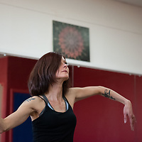 Leaf Ashley, 43, owner and instructor of the Bright Life Art Studio shows one of the movements for the dance routine she and her troupe will preform on Tuesday in Gallup.