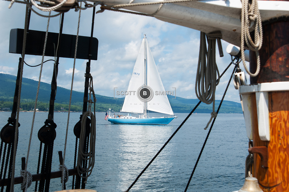 Nice day to sail aboard a three masted schooner and ejnoy the sight of other sailors.