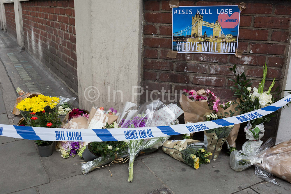 In the aftermath of the London Bridge and Borough Market terrorist attack the previous night, flowers are starting to appear a half a mile from the crime scene where 7 people were killed and many others injured Sundays total. On Sunday 4th June 2017, in the south London borough of Southwark, England.