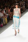White pants with lace train, openweave top. By Custo Barcelona at the Spring 2013 Fashion Week show in New York.