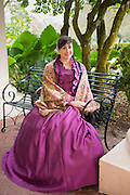 Tour guide in historic costume at Oak Alley plantation antebellum mansion house by Mississippi at Vacherie, Louisiana, USA