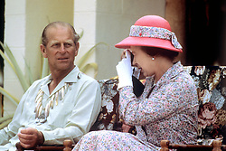 Queen Elizabeth II and the Duke of Edinburgh taking photographs during their visit to the South Sea Islands of Tuvalu.