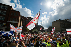 """© London News Pictures. 07/09/2013. London, UK.  Members of the EDL (English Defence League) March in the Borough of Tower Hamlets in East London on September 7, 2013. The group claim that the area is """"subject to Sharia law"""".  Photo credit: Ben Cawthra/LNP"""