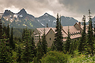 Clouds cross the Tatoosh Range with the Paradise Inn in the foreground at Paradise Meadows in Mount Rainier National Park, WA, USA
