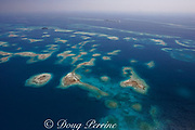 aerial view of small sand and coral cayes and coral bommies inside southern Belize barrier reef in vicinity of Placencia, Belize, Central America ( Caribbean Sea )