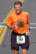 Middletown, New York - Warren Gilman of Middletown nears the finish line in the Orange Regional Medical Center's Run 4 Downtown road race on Aug. 16, 2014. All the proceeds from the Run 4 Downtown go to revitalizing Middletown's Historic district.