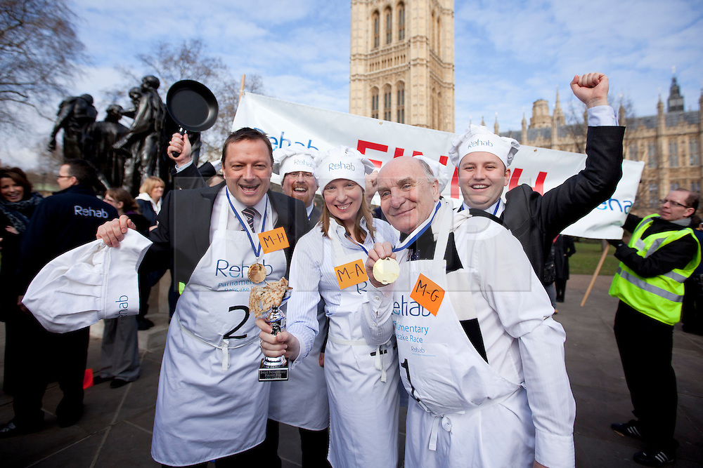 © Licensed to London News Pictures. 21/02/2012. LONDON, UK. The winning team of MPs pose for a picture after their victory during the annual Rahab Parliamentary Pancake Race. L-R Jason McCartney (Con), Julian Huppert (Lib Dem), Tracey Crouch (Con), Stephen Pound (Lab) and Ian Murray (Lab). Lords, Members of Parliament and political journalists today took part in the 2012 'Rehab Parliamentary Pancake Race' in aid of disability charity Rehab. The parliamentary team took the trophy after an extra lap was run due to widespread cheating. Photo credit: Matt Cetti-Roberts/LNP