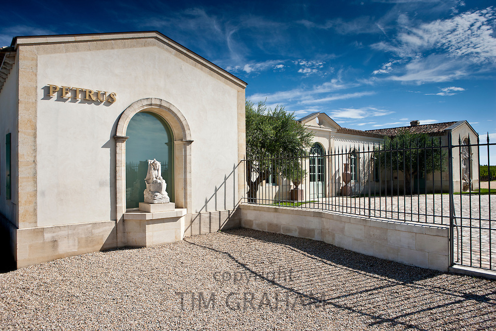 The famous Chateau Petrus wine estate, with statue of St Pierre, at Pomerol in the Bordeaux region of France