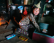 Sonam, 9 years old, packs her school material, tomorrow is the first day of school. Life at Mr and Ms Wangchuk's house on the edge of the Laya village.Life at Mr and Ms Wangchuk's house on the edge of the Laya village.