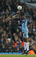 Moussa Dembele of Celtic tussles with Tosin Adarabioyo of Manchester City during the Champions League Group C match at the Etihad Stadium, Manchester. Picture date: December 6th, 2016. Pic Simon Bellis/Sportimage