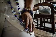 A Santeria priest explains the nature-based core of his religion. Trinidad, Cuba