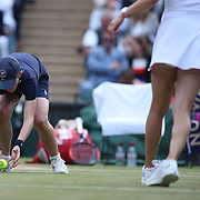 LONDON, ENGLAND - JULY 14: A ball boy in action on Center Court during the Wimbledon Lawn Tennis Championships at the All England Lawn Tennis and Croquet Club at Wimbledon on July 14, 2017 in London, England. (Photo by Tim Clayton/Corbis via Getty Images)