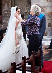 STRICT EMBARGO TO 00:01 FRIDAY 15 APRIL 2011 © licensed to London News Pictures. LONDON, UK  12/04/11. The filming of a new T-Mobile advert in which Kate Middleton and Prince William lookalikes pretend to get married at a mock royal wedding. The filming took place at St Bartholomew the Great Church in London. All the main royal family members and the Arch Bishop of Canterbury were played by actors. The actors danced down the aisle with moves choreographed by Louie Spence. Please see special instructions. Photo credit should read Cliff Hide/LNP.