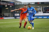 Luton Town defender Matty Pearson (6) and Peterborough Utd midfielder Siriki Dembélé (10)  during the EFL Sky Bet League 1 match between Luton Town and Peterborough United at Kenilworth Road, Luton, England on 19 January 2019.
