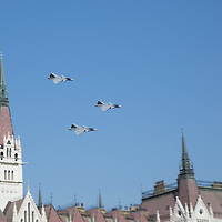 Hungarian Air Force JAS-39 Gripen fighter jet planes perform a low fly by over Parliament during an Air show that celebrates Hungarian national holiday on the anniversary of state foundation in Budapest, Hungary  on Aug. 20, 2018. ATTILA VOLGYI