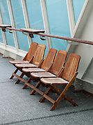 Deck chairs on the deck of a cruise ship in the middle of snowfall in the Finnmark region of norther Norway