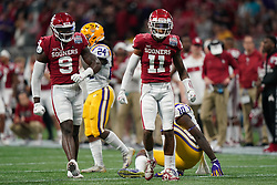 Parnell Motley #11 and Kenneth Murray #9 of the Oklahoma Sooners react to a play during the first half against the LSU Tigers in the 2019 College Football Playoff Semifinal at the Chick-fil-A Peach Bowl on Saturday, Dec. 28, in Atlanta. (Paul Abell via Abell Images for the Chick-fil-A Peach Bowl)