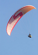 Ellenville, NY - A paragliders soars in the sky above Ellenville on May 30, 2009.