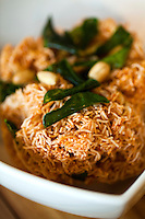 """Mee krob is a Thai dish; the name literally means """"crisp noodles""""  made with rice noodles and a sauce that is predominantly sweet but can be balanced with an acidic flavor, usually lemon or lime. Peanuts and holy basil compliment the complex flavors in this unique dish."""