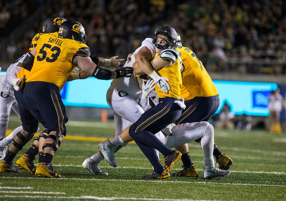 Sept 29 2018 - Berkeley, CA  U.S.A. California quarterback Chase Garbers (7) get sack during the NCAA Football game between Oregon Ducks and the California Golden Bears 24-42 lost at California Memorial Stadium.  Thurman James / CSM
