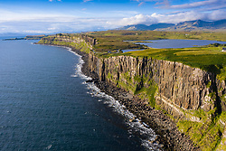 Aerial view of sea cliffs at Staffin on Trotternish peninsula on Isle of Skye, Scotland, UK