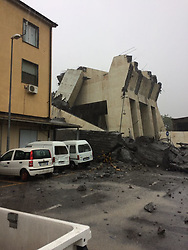 GENOA, Aug. 14, 2018  - Genoa, Italy - The remains of a partially collapsed bridge in Genoa, Italy. At least 20 people have died in the collapse of a major motorway bridge in the northwest Italian city of Genoa on Tuesday. (Credit Image: © Xinhua via ZUMA Wire)