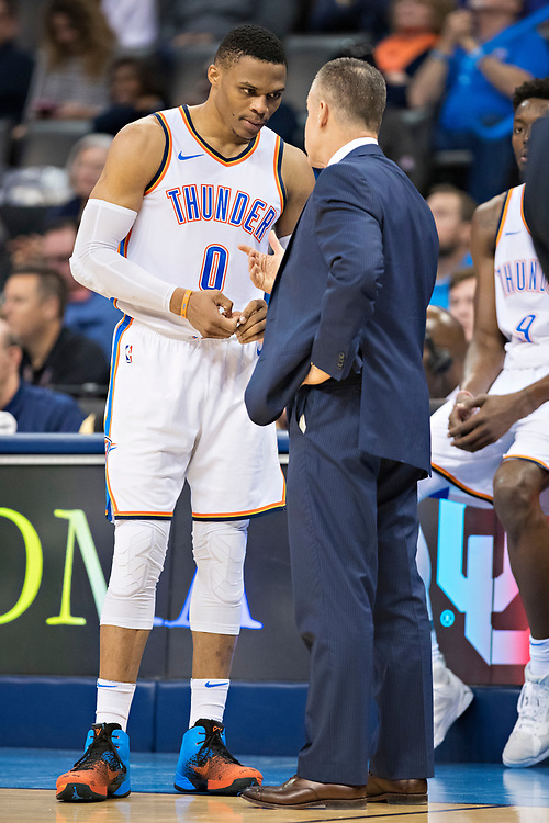 OKLAHOMA CITY, OK - OCTOBER 25:  Head Coach Billy Donovan and Russell Westbrook #0 of the Oklahoma City Thunder talk during a time out during a game against the Indiana Pacers at the Chesapeake Energy Arena on October 25, 2017 in Oklahoma City, Oklahoma.  NOTE TO USER: User expressly acknowledges and agrees that, by downloading and or using this photograph, User is consenting to the terms and conditions of the Getty Images License Agreement.  The Thunder defeated the Pacers 114-96.  (Photo by Wesley Hitt/Getty Images) *** Local Caption *** Billy Donovan; Russell Westbrook