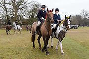 Horses decorated in tinsel and their riders arrive for the traditional Chiddingfold, Leconfield and Cowdray Boxing Day Hunt, which sets off from the kennels at Petworth House in Petworth Park, West Sussex, UK on December 26, 2018