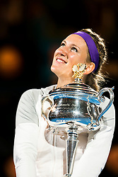 © Licensed to London News Pictures. 26/01/2013. Melbourne Park, Australia. Victoria Azarenka hugs her winner trophy while looking up at the sky her during the Womens Final between Victoria Azarenka and Li Na of the Australian Open. Photo credit : Asanka Brendon Ratnayake/LNP