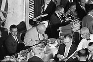 1959. Nikita Khrushchev eating, totally concentrated on his food in the Washington D.C. Press Club.<br /> <br /> 1959. Nikita Khrouchtchev mange avec grande concentration lors d'un déjeuner au Club de la Presse de Washington DC .