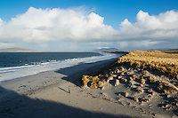 Woman walks on west beach, Berneray, Outer Hebrides, Scotland