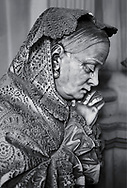 Picture and image of the stone sculpture of a mouring women in the Bourgeois Realistic style. Badaracco Tomb sculpted by G Moreno 1878. The monumental tombs of the Staglieno Monumental Cemetery, Genoa, Italy .<br /> <br /> Visit our PEOPLE & PLACES PHOTO ART COLLECTIONS for more photos to buy as buy as wall art prints https://www.photoshelter.com/mem/images/index#/C00001WetsxVxNTo/ .<br /> <br /> Visit our LANDSCAPE PHOTO ART PRINT COLLECTIONS for more wall art photos to browse https://funkystock.photoshelter.com/gallery-collection/Places-Landscape-Photo-art-Prints-by-Photographer-Paul-Williams/C00001WetsxVxNTo