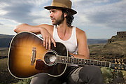 "Alejandro Rose-Garcia of Shakey Graves poses for a portrait backstage at Sasquatch! Music festival on May 24, 2014. Gear: Nikon D750, Nikon 28-70mm Lens, Speedotron Black Line 1205cx, 22"" Speedotron beauty dish with 30 degree grid for highlight."
