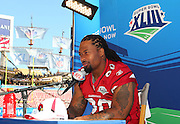 TAMPA, FL - JANUARY 27: Defensive tackle Darnell Dockett #90 of the NFC Arizona Cardinals speaks to the media during Super Bowl XLIII Media Day at Raymond James Stadium on January 27, 2009 in Tampa, Florida. ©Paul Anthony Spinelli *** Local Caption *** Darnell Dockett