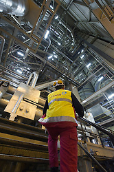 An employee climbs stairs in the boiler of the Essent Energie power station, in Geertruidenberg, Netherlands, on Monday March 22, 2010. Essent Energie is owned by RWE AG. (Photo © Jock Fistick).