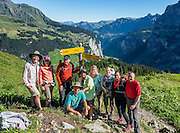Tanzbodeli trail base in Upper Lauterbrunnen Valley. Behind our group see Gimmelwald village (near) and Wengen (far) Switzerland, Europe. We loved hiking to the quiet retreat of Berghotel Obersteinberg, which offers tremendous views of waterfalls and peaks in Upper Lauterbrunnen Valley. Lit by candle light at night, this romantic escape built in the 1880s recalls an earlier era without power. The main luxuries here are flush toilets down the hall, and traditional Swiss hot meals. The private double rooms lack electricity, and bowls of water serve as bath and sink. Obersteinberg is a 2-hour walk from Stechelberg, or 4 hours from Mürren, in one of the world's most spectacular glaciated valleys. From Obersteinberg, don't miss the 2-3 hours round trip to the deep-blue tarn of Oberhornsee in the upper glacial basin, beneath snowcapped Grosshorn, Breithorn and Tschingelhorn. The Swiss Alps Jungfrau-Aletsch region is honored as a UNESCO World Heritage Site. For licensing options, please inquire.