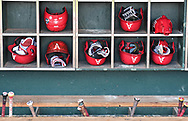 A general view of the Arkansas Razorbacks batting helmets and bat case in the dugout before game one against the Oregon State Beavers of the College World Series Championship Series at TD Ameritrade Park in Omaha, Nebraska.