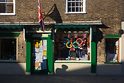 Misuse of the copyrighted Olympic ring brand in a shop window at the Suffolk seaside town of Southwold, Suffolk. The shadow of passing people can be seen on the lower wall of this small business in this old building at this traditional English seaside resort that lacks advertising and branding, the day before the opening of the London 2012 Olympic opening ceremony.