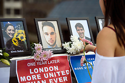 © Licensed to London News Pictures. 03/06/2018. London, UK. Pictures of some of the eight victims are placed at the scene of the attack ahead of a minutes silence for the victims of the 2017 London Bridge Terror attack, held on London Bridge. Eight people were killed and 48 were injured when a van was deliberately driven into pedestrians on London Bridge. Three occupants then ran to the nearby Borough Market area carrying knives and fake explosives. Photo credit: Ben Cawthra/LNP