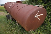 arrow on rusty metal container on wheels