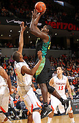 Dec. 17, 2010; Charlottesville, VA, USA; Oregon Ducks guard Teondre Williams (22) shoots the ball over Virginia Cavaliers forward Akil Mitchell (25) during the first half of the game at the John Paul Jones Arena. Mandatory Credit: Andrew Shurtleff-
