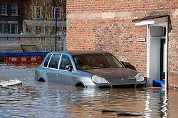 © Licensed to London News Pictures. 26/02/2020. Bewdley, UK. A car sits in flood water in the village of Wribbenhall on the eastern side of the Severn in Bewdley. Photo credit: Peter Manning/LNP