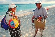 MEXICO, YUCATAN, TOURISM Riviera Maya; Playacar beach vendors