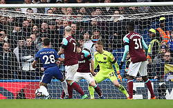 Chelsea's Cesar Azpilicueta (left) scores his side's first goal of the game