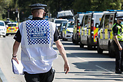 A Hertfordshire Police Incident Commander oversees a policing operation to remove HS2 Rebellion activists who had used a lock-on arm tube to block a gate to the South Portal site for the HS2 high-speed rail link on 14 September 2020 in West Hyde, United Kingdom. Anti-HS2 activists blocked two gates to the same works site for the controversial £106bn rail link, one remaining closed for over six hours and another for over twelve hours.