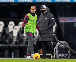 NEWCASTLE-UPON-TYNE, ENGLAND - Wednesday, December 30, 2020: Liverpool's Thiago Alcantara warms-up at half-time as manager Jürgen Klopp looks on during the FA Premier League match between Newcastle United FC and Liverpool FC at St. James' Park. The game ended in a goal-less draw. (Pic by David Rawcliffe/Propaganda)